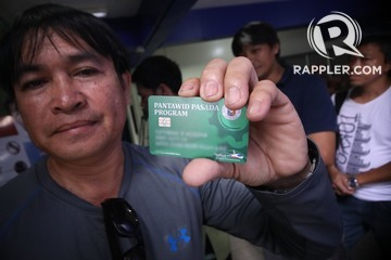 9ef060ed2 A jeepney driver shows his Pantawid Pasada Program cash card on August 28,