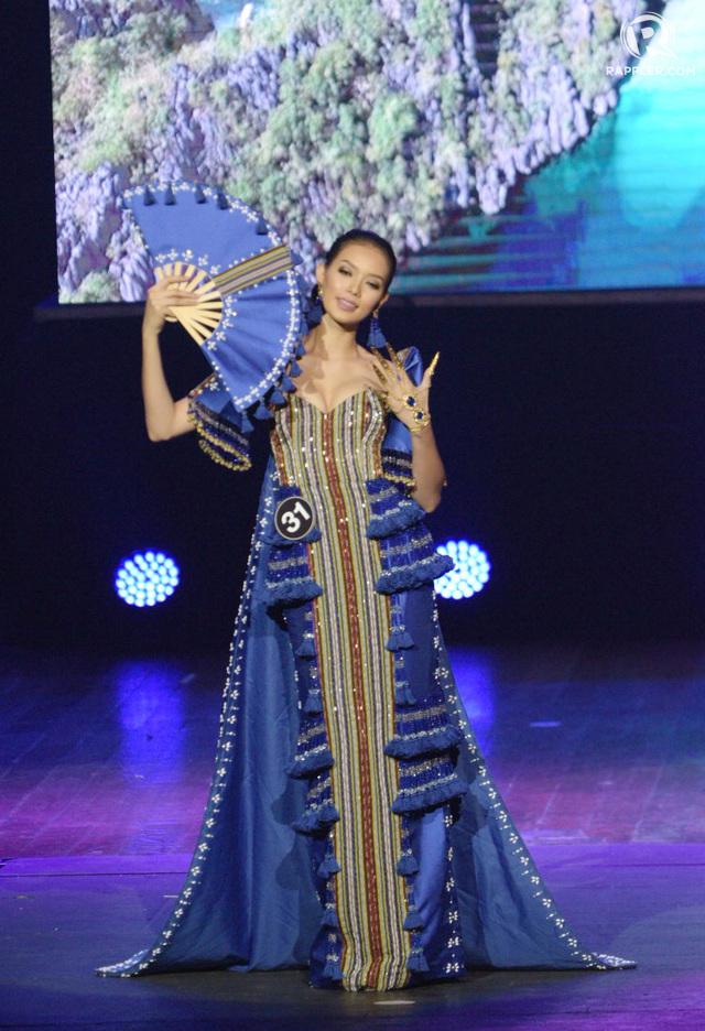 BLUE AND TRIBAL. Jehza Huelar wears a modern terno.
