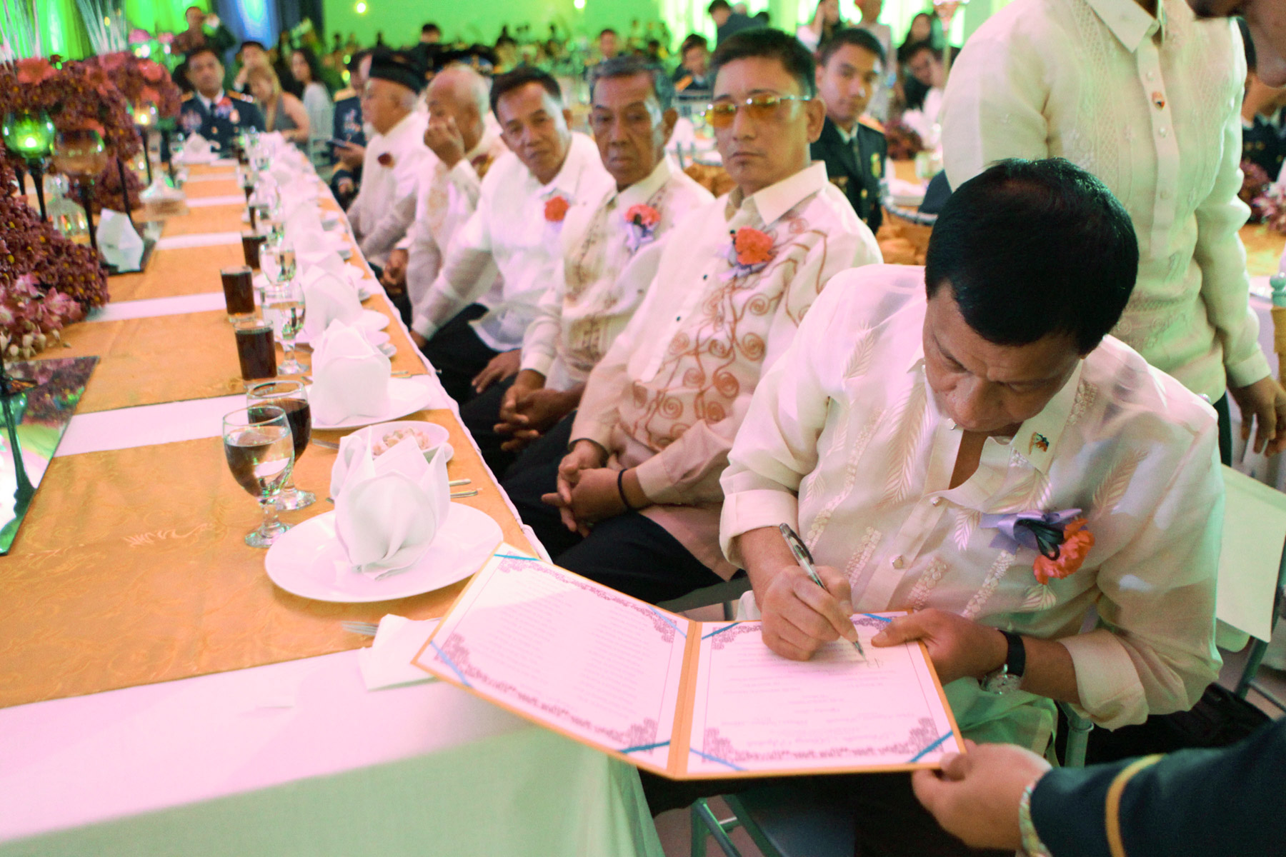 Duterte goes to wedding of cop who proposed in front of him