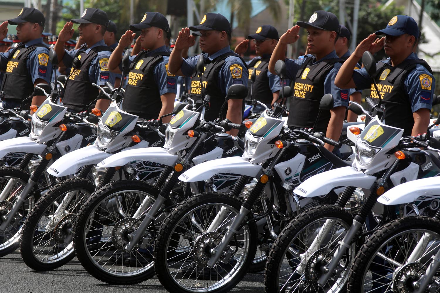 READY FOR SHOOTERS. Quezon City cops accept motorcycles from the city government to fight riding