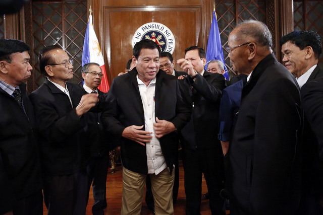SUITING UP. President Rodrigo Duterte tries on the suits given to him by his adoptive PMA class, the 'Dimasupil' Class of 1967 in Malacañang on November 7, 2016. Photo by Richard Madelo/Presidential Photo