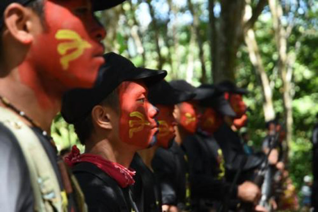 'TERRORIST ORGANIZATION.' President Rodrigo Duterte signs a proclamation declaring the Communist Party of the Philippines-New People's Army as a terrorist organization. File photo