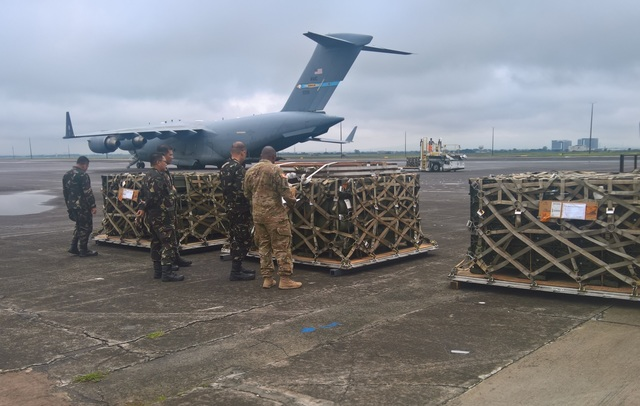 US SUPPORT. Members the US and Philippine armies unload and inspect a delivery of  rockets from the US to the Armed Forces of the Philippines at Clark Air Base, Pampanga. Photo from the US Embassy