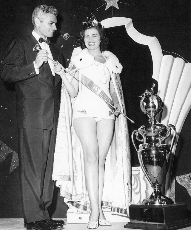 MISS UNIVERSE 1953. France's Christiane Martel poses with judge Jeff Chandler. Photo from Miss Universe Organization