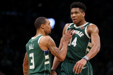 b5466f9c411 BIG BUCKS. George Hill (left) and Giannis Antetokounmpo deliver the goods  for the