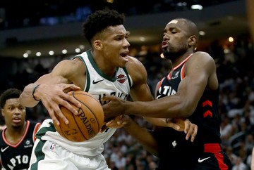 1deb64f3fec1 RALLY. Giannis Antetokounmpo and the Bucks get going late against Serge  Ibaka and the Raptors